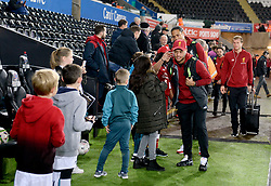 Liverpool's Alex Oxlade-Chamberlain interacts with fans as he arrives at the stadium