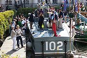 Boats and people and flags at St Katherine Docks. Totally Thames takes place over the whole month in September, combining arts, cultural and river events presented by Thames Festival Trust throughout the 42-mile stretch of the River Thames in London, UK.