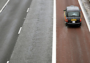 ©London News pictures. 04/10/2010. Motorists and hauliers are to benefit from an extra lane on a key stretch of the M4 near London, Transport Secretary Philip Hammond announced today, Monday 4th October 2010. The M4 bus lane, which runs from Heathrow to the capital, is to be scrapped.