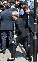 © Licensed to London News Pictures. 19/06/2017. London, UK. Prime Minister Theresa May arrives at Finsbury Park Mosque after tripping and losing her shoe on arrival. Earlier a van ploughed into a crowd near Finsbury Park Mosque, as they finished taraweeh, Ramadan evening prayers. One person has been killed and 10 people are injured. Photo credit: Peter Macdiarmid/LNP