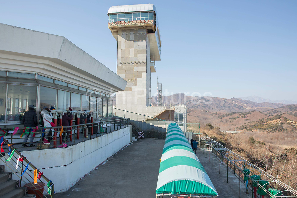 The Goseong Unification Observatory overlooks the DMZ Demilitarised Zone on 06th February 2016 in South Korea. Open specially for the 2018 Winter Olympic and Paralympics, the site is also known as the Geumgangsan Observatory, and is a military area normally restricted to the public. Views stretch into North Korea overlooking the Geumgangsan Mountains and the Korean Demilitarised Zone, a strip of land running across the Korean Peninsula deciding the two nations. The Path to Peace tour was organised by PyeongChang and The Ministry of Culture, Sports and Tourism.