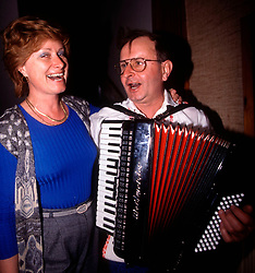 CZECH REPUBLIC MORAVIA BANOV APR98 - Anicka Benickova (L) sings with Jiri Chovanec during his visit to her home during Easter 98.  During Easter, folklore dress, music and mutual visits are part of the customary traditional celebrations in Moravia.  jre/Photo by Jiri Rezac<br /> <br /> © Jiri Rezac 1998<br /> <br /> Tel:   +44 (0) 7050 110 417<br /> Email: info@jirirezac.com<br /> Web:   www.jirirezac.com