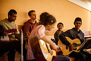 Young Roma inhabitants from Lunik IX joining a church service at the pastoral centre of the Salesians of Don Bosco mission in Lunik IX in Kosice. Volunteer Katka (in front). The Salesians are supported by volunteers which are helping the Roma residents with different aspects of their lives. The LUNIK IX housing complex - populated with almost 100% Roma inhabitans - in the western-central part of the city of Kosice located in Eastern Slovakia. The living conditions in Lunik IX are partly very bad and many people do not have electricity, water or gas. Some of the buildings are completely devasted.