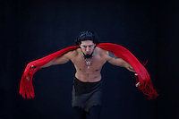 Masculine ceremony shamanic man. Dark and Handsome powerfully expressed man with red scarf.<br /> <br /> <br /> The color Red is the color of physical energy, passion, courage, power, will, and desire. The Root Chakra is stable and grounding.<br /> <br /> Red is powerfully linked to our most primitive physical and emotional needs of survival and self preservation<br /> <br /> Red symbolizes energy, action, confidence, courage, and change. The color red brings passion and strength to your relationships, your life and your work.