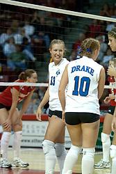 20 November 2004....Megan Veltman smiles at Sarah Schuster who just scored a point on a block.....Illinois State University Redbirds V Drake Bulldogs Women's Volleyball.  Redbird Arena, Illinois State University, Normal IL