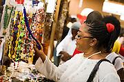 A visitor looks at jewelry at the 22nd Salon International de l'Artisanat de Ouagadougou (SIAO) in Ouagadougou, Burkina Faso on Sunday November 2, 2008.