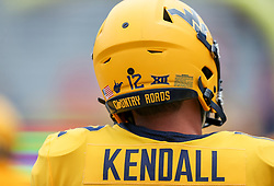 Sep 14, 2019; Morgantown, WV, USA; West Virginia Mountaineers quarterback Austin Kendall (12) warms up before their game against the North Carolina State Wolfpack at Mountaineer Field at Milan Puskar Stadium. Mandatory Credit: Ben Queen-USA TODAY Sports