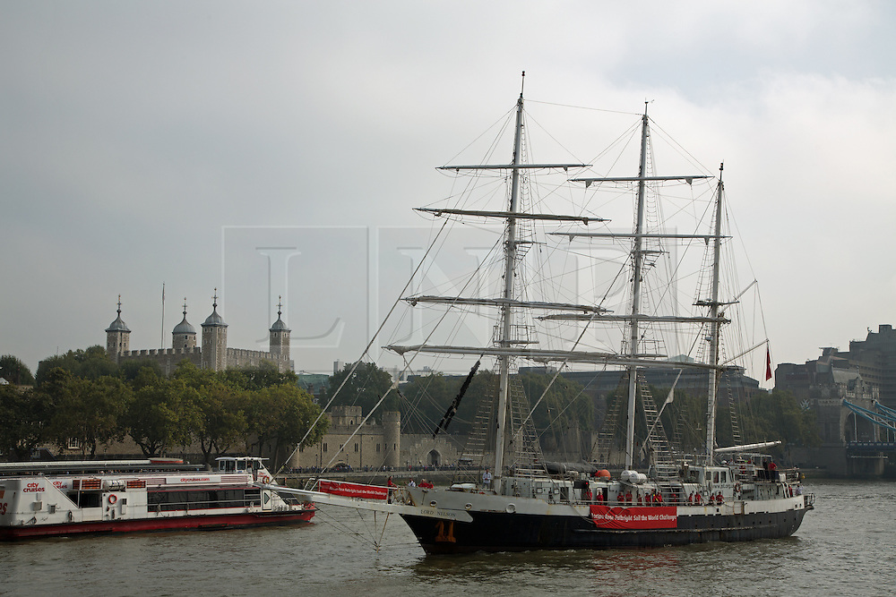 © Licensed to London News Pictures. 19/09/2014. Lord Nelson passes the Tower of London.  The tall ship Lord Nelson has arrived back in the UK after completing the 50,000 nautical mile Norton Rose Fulbright Sail the World Challenge. She passed through Tower Bridge this morning and moored alongside HMS Belfast where she received a rousing welcome from the Royal Marines Band. Lord Nelson was accompanied up the river by her sister ship Tenacious. Both vessels are accessible for able bodied and disabled sailors and are owned by the Jubilee Sailing Trust charity. JST was named as the National Lottery's 2014 Sports Charity of the Year. Credit : Rob Powell/LNP