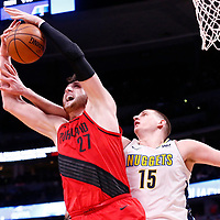 09 April 2018: Portland Trail Blazers center Jusuf Nurkic (27) vies for the rebound with Denver Nuggets center Nikola Jokic (15) during the Denver Nuggets 88-82 victory over the Portland Trail Blazers, at the Pepsi Center, Denver, Colorado, USA.