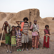 Dad Muhammed, Hassan,Hussein,Muhammed,Abdo and Rabia have all come to drink. The mother Hawa is heading off with the goats in back ground. It's dry season in Afar and water is hard to come by. Here a hole has been dug into the river bed to be able to find something to drink. Both animals and humans suffer in the dry season and travel long distances to find water and grassing.  Rabia and her family are pastoralists and have come to water their goats. Action for Integrated Sustainable Development Association (AISDA) work in the AFAR region of Eastern Ethiopia, based in Delafagi. The Afars practise an old tradition of Female Genital Mutilation where the baby girls has her clitoris and labia cut away and her vagina sewn up. The day before her wedding day the girl is un-stiched ready for marriage. Its a brutal and barbaric tradition which AISDA is challenging with great effect, now more than a hundred girls in Dowe district have been saved from the knife and AISDA is now rolling out the scheme in Delafagi. Delafagi is where the oldest ever human remains have been found, the found is thought to be 4.5 mill years old.
