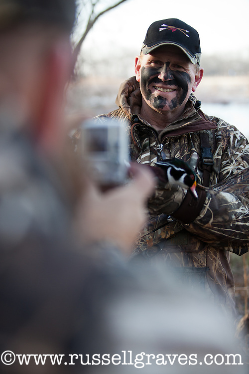 hunters taking photos after a successful duck hunt