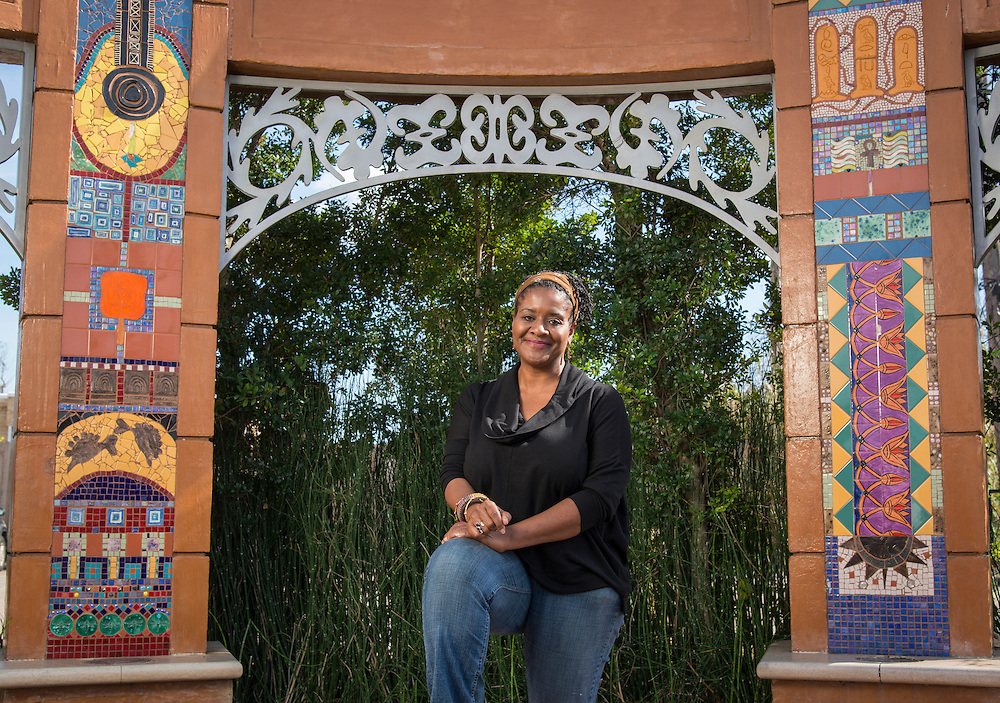 """Lamar High School graduate and artist Marsha Dorsey Outlaw poses for a photograph at her installation """"Vigango's Stoop"""", January 29, 2015."""