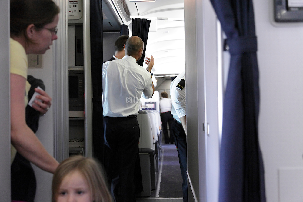 passengers with child inside an airplane