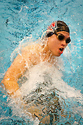 David Achio-Mendez '13 makes a turn during the Men's 100 yard Breaststroke at the Grinnell College Pioneer Invitational..BEN BREWER/Grinnell College