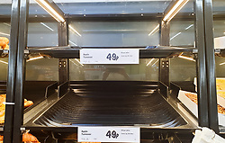 © Licensed to London News Pictures. 22/07/2021. London, UK. Empty shelves bakery products in Lidl in Tottenham, north London after food shortage fears due to the pingdemic. A number of supermarkets are reporting empty shelves as they, wholesalers and hauliers are struggling to ensure food and fuel supplies after the Covid-19 NHS app alerted workers to isolate after being in contact with someone with COVID-19. Photo credit: Dinendra Haria/LNP