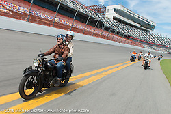 Paul D'Orleans and Susan McLaughlin riding on the Daytona International Speedway on Thursday before the Friday morning start of the Motorcycle Cannonball Cross-Country Endurance Run. Daytona Beach, FL, USA. September 4, 2014.  Photography ©2014 Michael Lichter.