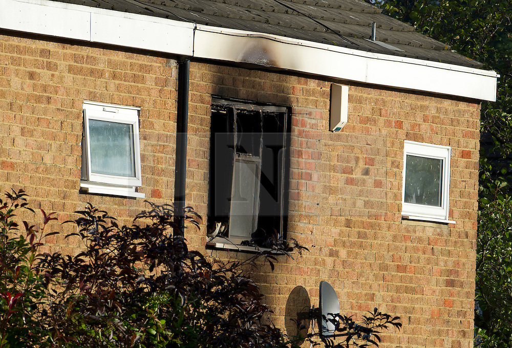 ©  London News Pictures. 15/10/2012. Harlow, UK. A burnt out window at a property on Barn Mead, Harlow, Essex where three children and a woman have died and three others are in hospital following a house fire. Two boys aged 13 and six, a girl aged 11 and the woman were declared dead at the scene. A nine-year-old boy and a three-year-old girl have serious burns and a man has minor burns. Photo credit : Ben Cawthra/LNP