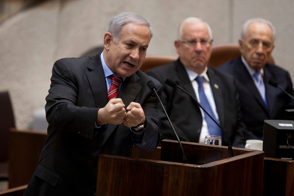 Israel's Prime Minister Benjamin Netanyahu (L) speaks as Israel's President Shimon Peres (R) and Speaker of the Knesset Reuven Rivlin (C) listen, during a special session celebrating the 63rd birthday of the Knesset, Israel's parliament in Jerusalem, on February 8, 2012.