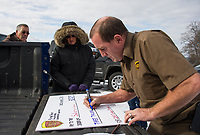 With donations coming in totaling $3,126.00 the UPS Team decided to keep the tradition of the Turkey Plunge alive at Bartlett Beach on Saturday morning.  (Karen Bobotas/for the Laconia Daily Sun)