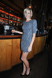 JENNI FALCONER at a party to celebrate the launch of the Omega 2009 Constellation Collection of watches held at Almada, Berkeley Street, London on 15th October 2009.