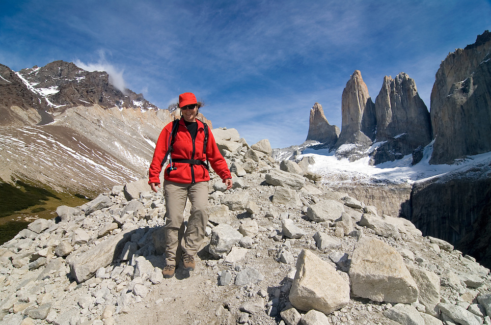 Woman hiking on a moraine below Torres Del Paine, Torres Del Paine National Park, Chile.