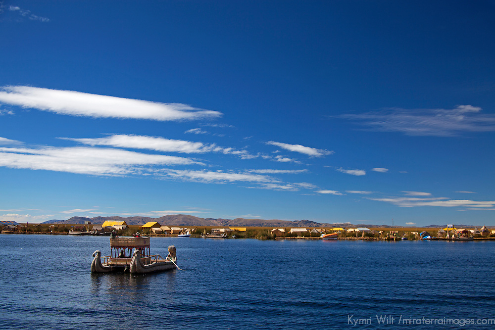 South America, Peru, Uros Islands. Reed boat and floating reed islands of Lake Titicaca.