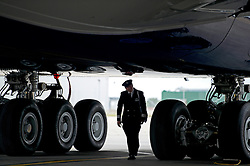 © London News Pictures. 04/07/2013 . London, UK.  A British Airways pilot walks beneath a new British Airways Boeing A380 superjumbo which arrived at Heathrow Airport. It was the first time British Airlines have taken delivery of the new plane, making British Airways the first European airline to operate both the 787 and A380. Photo credit : Ben Cawthra/LNP