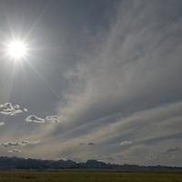 Hot, mid-day sun over mountains in the Gobi Desert, near Dalanzadgad, Mongolia.