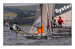The 2004 Skiff Nationals at Largs held by the SSI.<br /> <br /> Andy Richards, Andy Fairlie and Dave Richards onboard Radii.<br /> <br /> Marc Turner / PFM Pictures
