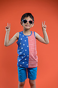High quality stock photo of a 7 year old boy wearing Summer fashion wear in the studio