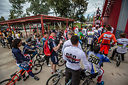 Riders waiting to get to the start gate during the practice session at the 2016 UCI BMX Supercross World Cup in Santiago del Estero, Argentina