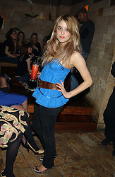 PEACHES GELDOF at a party hosted by Daniella Helayel of fashion label ISSA held at Taman Gang, 141 Park Lane, London on 15th February 2006.<br />