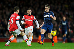 Man Utd Midfielder Michael Carrick (ENG) is challenged by Arsenal Defender Laurent Koscielny (FRA) - Photo mandatory by-line: Rogan Thomson/JMP - 07966 386802 - 12/02/14 - SPORT - FOOTBALL - Emirates Stadium, London - Arsenal v Manchester United - Barclays Premier League.