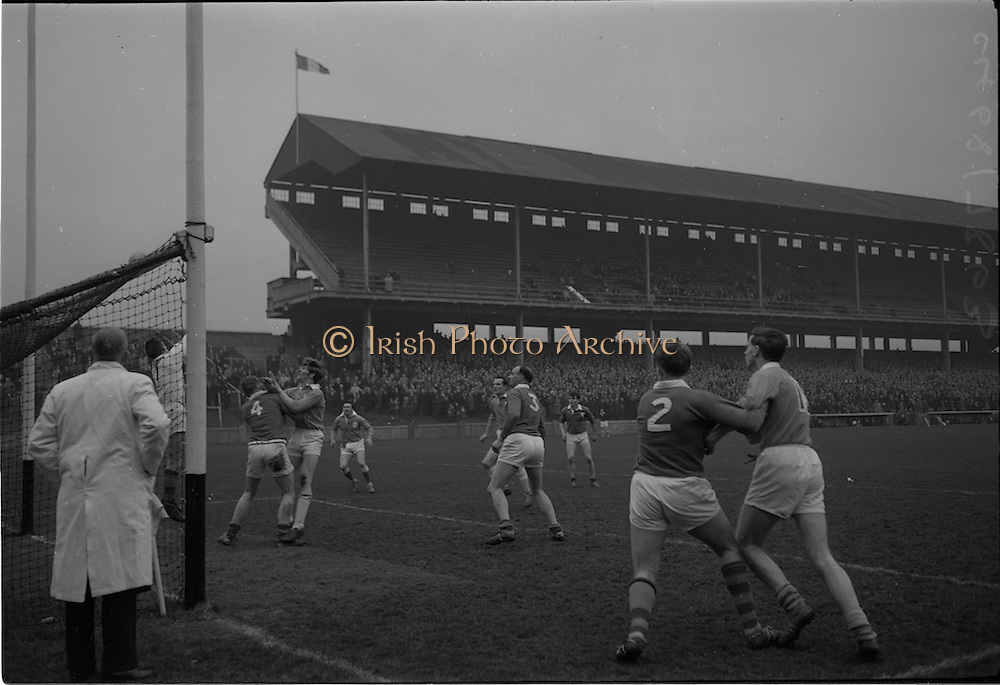21/02/1965<br /> 02/21/1965<br /> 21 February 1965<br /> Munster v Ulster Railway Cup semi-final at Croke Park. The final score was Ulster 0-14 Munster 0-9.<br /> the Munster back-line of P. O'Donoghue (4), N. Sheehy (3) and M. Morris (2) try to halt an Ulster attack.