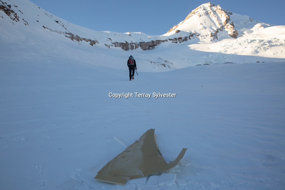 Randy Lee, 45, of Hood River, passes a piece of airplane debris on Thursday, January 31, 2019, while climbing beneath the site of a plane crash on the Eliot Glacier on Mount Hood. The pilot, George Regis, 63, died in the crash while reportedly flying from his home in Battleground, Washington, to Arizona.