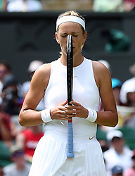 Victoria Azarenka reacts on day three of the Wimbledon Championships at the All England Lawn Tennis and Croquet Club, Wimbledon.