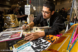 pin-striping area at the Annual Mooneyes Yokohama Hot Rod and Custom Show. Japan. Sunday, December 7, 2014. Photograph ©2014 Michael Lichter.