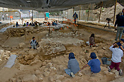 Volunteers and archaeologists at an archaeological excavation site in Jaffa, Israel  This is a preservation dig done to enable continued construction on the site