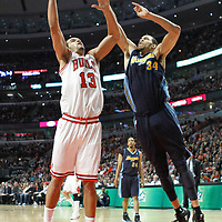 26 March 2012: Chicago Bulls center Joakim Noah (13) goes for the dunk on Denver Nuggets center JaValee McGee (34) during the Denver Nuggets 108-91 victory over the Chicago Bulls at the United Center, Chicago, Illinois, USA. NOTE TO USER: User expressly acknowledges and agrees that, by downloading and or using this photograph, User is consenting to the terms and conditions of the Getty Images License Agreement. Mandatory Credit: 2012 NBAE (Photo by Chris Elise/NBAE via Getty Images)