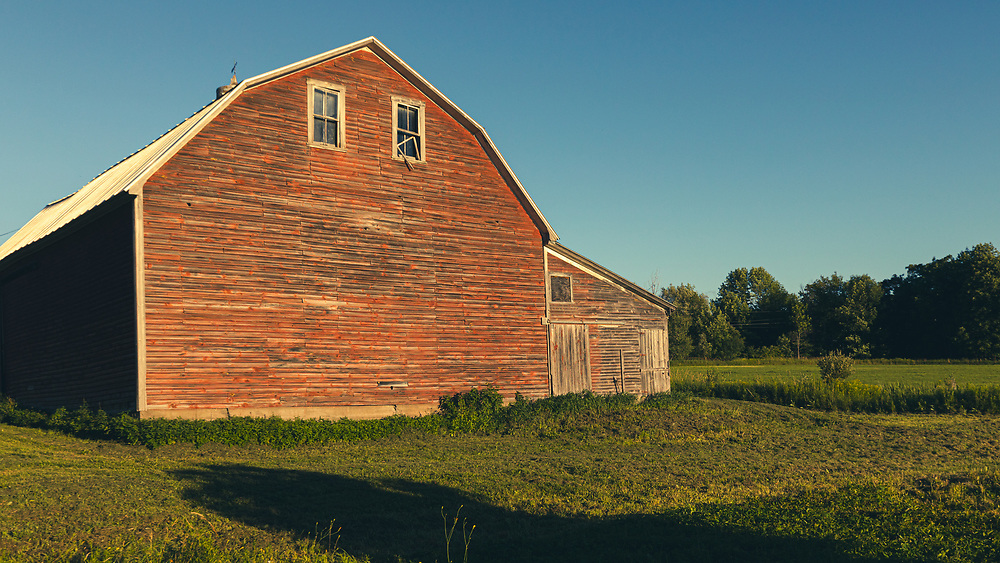 An old barn nested on a hilltop in Vermont.