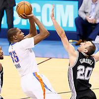 06 May 2016: Oklahoma City Thunder forward Kevin Durant (35) takes a jump shot over San Antonio Spurs guard Manu Ginobili (20) during the San Antonio Spurs 100-96 victory over the Oklahoma City Thunder, during Game Three of the Western Conference Semifinals of the NBA Playoffs at the Chesapeake Energy Arena, Oklahoma City, Oklahoma, USA.