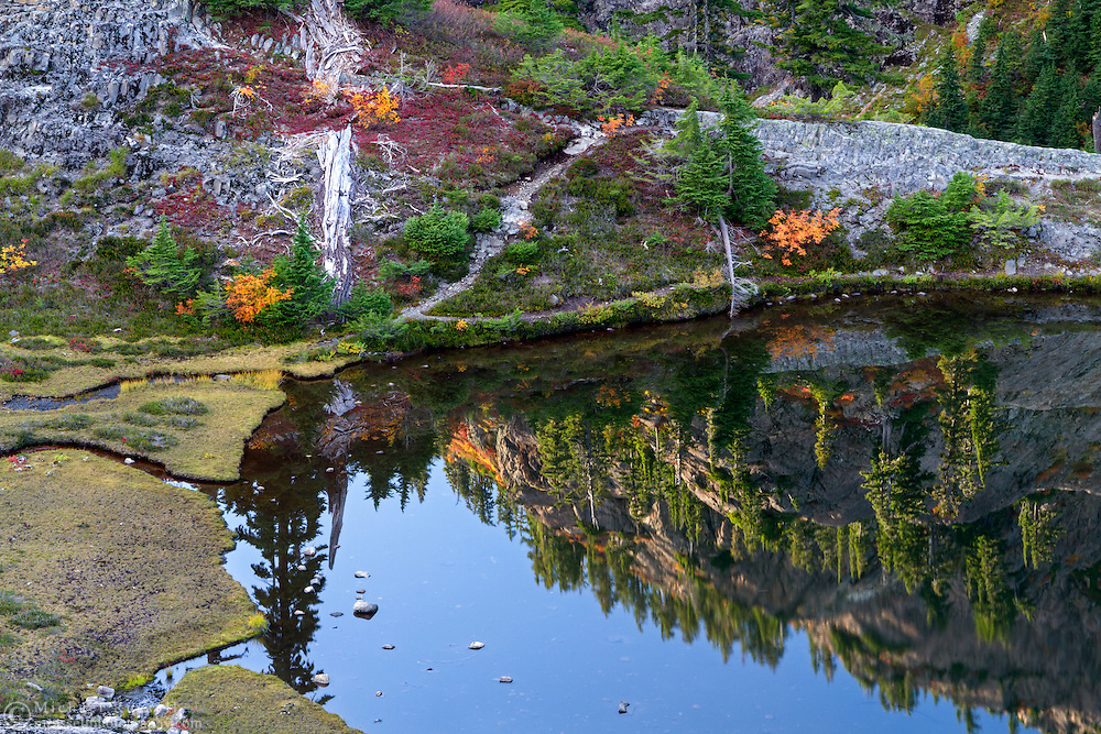 Mount Herman is reflected in Austin Pass Lake in the Heather Meadows and Bagley Lakes area of the Mount Baker-Snoqualmie National Forest of Washington State, USA.