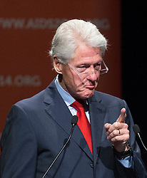 © Licensed to London News Pictures. 23/07/2014. Former US President Bill Clinton makes a gesture while speaking during a session of the 20th International AIDS conference held in Melbourne Australia. Photo credit : Asanka Brendon Ratnayake/LNP