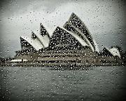 Sydney Opera House, through a rain spotted ferry window