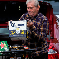 March 17, 2020, Temple City, California, USA: A man loads his vehicle with beer at outside a Ralph's supermarket. California Governor Newsom on Sunday called for all California bars to close and for all seniors to self-isolate. Many movie theaters and other public venues have closed their doors, while other businesses remain open for normal business, as the spread of Coronavirus (COVID-19) continues. (Credit Image: © Ringo Chiu/ZUMA Wire)