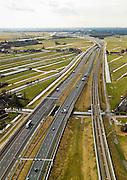 Nederland, Zuid-Holland, Gemeente Alkemade, 20-02-2012; infrastructuur bundel bestaande uit autosnelweg A4 en het hogesnelheidspoor HSL-Zuid (re) doorkruist het veenweidelandschap tussen Roelofarendsveen en kruist de Rijpwetering. .Infrastructure bundle consisting of A4 motorway and the high-speed (r) crosses the bog meadows area between Roelofarendsveen and Rijpwetering..luchtfoto (toeslag), aerial photo (additional fee required).copyright foto/photo Siebe Swart