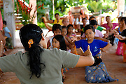Teacher and pupils at traditional Balinese dance school. Sanur, Bali, Indonesia
