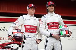 Drivers Kimi Raikkonen (left) and Antonio Giovinazzi during the new livery presentation of Alfa Romeo's F1 car at the Circuit de Barcelona-Catalunya.