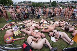 "© Licensed to London News Pictures.  <br /> 17/06/2018; Bristol, UK. Symbolic ""die-in"" to commemorate the 23 cyclists that have been killed on Bristol's roads, at The World Naked Bike Ride through Bristol city centre. The event sees hundreds of naked and near naked cyclists cycle around Bristol city centre to campaign for improved cycle routes in Bristol and to raise awareness of the dangers and vulnerability cyclists in the city face on a daily basis. The event included a symbolic ""die-in"" to commemorate the 23 cyclists that have been killed on Bristol's roads. Photo credit: Simon Chapman/LNP"