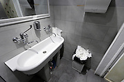 sink inside a bars public toilet